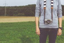 Free Man Standing Carrying Dslr Camera During Daytime Stock Image - 82936831