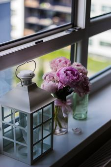 Free Candle Lantern Near Purple Petaled Flower On Glass Window Stock Images - 82937044