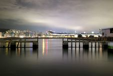 Free Cityscape View Over Sea With Lights Turned On During Night Royalty Free Stock Images - 82937239
