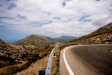 Free Gray Curve Road Under Cloudy Sky During Daytime Stock Photos - 82937963