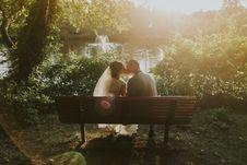 Free Wedding Couple On Bench Royalty Free Stock Image - 82937986