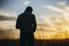 Free Silhouette Photography Of A Man Standing And Bow Down Head Stock Image - 82939201