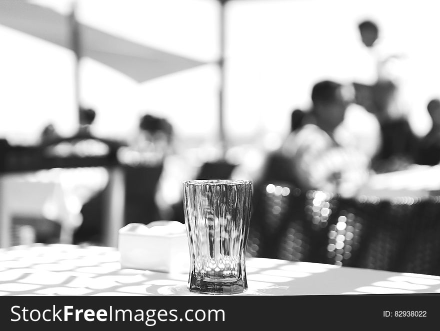 Clear Cut Glass Highball Drinking Glass at the Top of the Table Selective Focus Photography