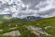 Free Green Grass Field With Rocks Near Mountains During Cloudy Daytime Sky Royalty Free Stock Photography - 82944617