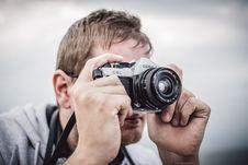 Free Man Holding Black Silver Bridge Camera Taking Photo During Daytime Royalty Free Stock Photo - 82944985