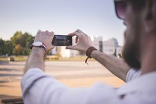 Free Tilt Shift Photo Of Man Holding Black Smartphone Taking Photo Of Gray Ground At Daytime Royalty Free Stock Image - 82944996