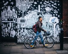 Free Man In Black Jacket Holding A Black Hardtail Bike Near Black And White Art Wall Stock Image - 82945191