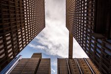 Free Worm S Eye View Of City Buildings Under Sunny Cloudy Sky Stock Photos - 82945273