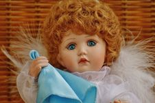 Free Girl Doll In White Fur Dress Holding Blue Handkerchief Stock Images - 82945424