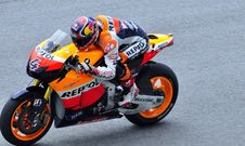Free Man In Repsol Orange White And Blue Motorcycle Racing Gear Riding Sports Bike Stock Photo - 82945990