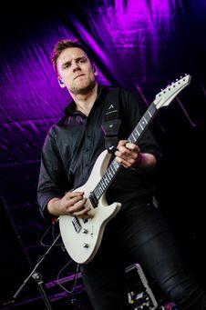 Free Man In Black Dress Shirt Playing Guitar Royalty Free Stock Image - 82946006