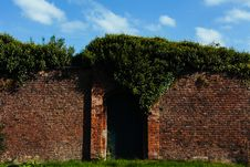 Free Tall Brick Wall With Closed Garden Gate Royalty Free Stock Photography - 82946717
