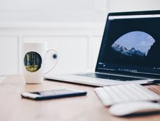 Free Macbook Pro Near White Yellow And Green Ceramic Mug And Apple Magic Keyboard Stock Images - 82946854