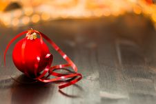 Free Red Christmas Bauble With Red Ribbon On Wooden Surface In Close Up Photography Royalty Free Stock Images - 82946859