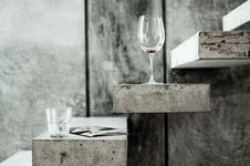 Free Clear Long Stem Wine Glass And Clear Drinking Glass On Grey Stairs Photo Royalty Free Stock Photo - 82946965
