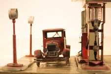 Free Antique Car And Gas Station Toys Royalty Free Stock Photo - 82947515