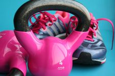 Free Kettle Bell Beside Adidas Pair Of Shoes Stock Images - 82947634
