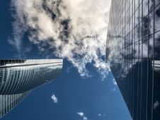 Free Worm S Eye View Of High Rise Building Under White Cloudy Sky Royalty Free Stock Photo - 82947775