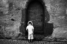 Free Grayscale Photo Of Toddler Standing And Wearing Hat On The Ground Stock Image - 82947891