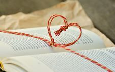 Free Yellow And Red Heart Knot On Black Labeled Book Royalty Free Stock Photo - 82948985