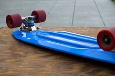 Free Blue Penny Board On Wooden Table Stock Image - 82949271