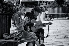 Free Greyscale Photography Of Man And Woman Playing Musical Instruments Stock Image - 82949281