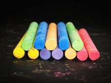 Free Pile Of Colored Chalk On Black Wooden Tabletop Stock Image - 82949311