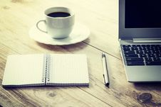 Free White Ceramic Cup On White Round Saucer Near Spiral Notebook Royalty Free Stock Image - 82949636