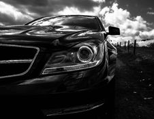 Free Gray Scale Photo Of Car On Side Of The Road Royalty Free Stock Photos - 82949738