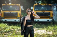 Free Portrait Of Woman With Trucks Royalty Free Stock Photos - 82949848