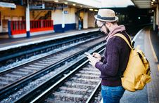 Free Man In Brown Hoodie Standing In Front Of Train Railway Stock Photo - 82949860