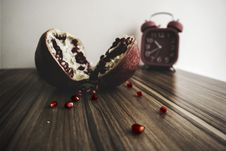 Free Red And White Round Fruit On Brown Wooden Table With Red Alarm Clock Royalty Free Stock Photography - 82949887