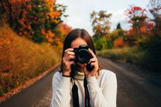 Free Woman In White Long Sleeve Shirt Taking Picture Royalty Free Stock Photography - 82950157
