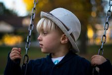Free Kid In Gray Round Hat On Hanging Swing Stock Images - 82950284