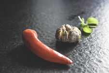 Free Red Chili Beside Brown Bead And Green Leaf Stock Images - 82950294