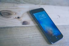 Free Space Gray Iphone On Wooden Surface Stock Photography - 82950302