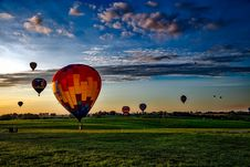 Free Colorful Hot Air Balloons In Field At Sunset Royalty Free Stock Images - 82950409