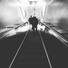Free Grayscale Photograph Of Man Walking Upstairs Stock Image - 82950601