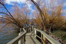 Free Wooden Boardwalk On Waters Edge Stock Photo - 82950610