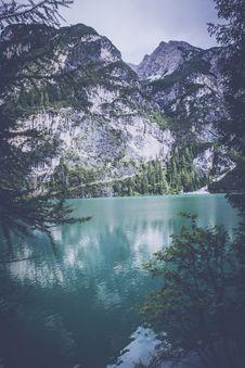 Free Lake Near White Mountain With Trees During Daytime Stock Image - 82950611