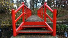 Free Red Bridge In Woods Royalty Free Stock Photography - 82950717