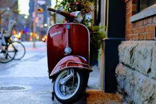 Free Vespa On City Sidewalk Royalty Free Stock Images - 82950919