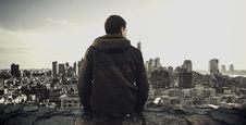 Free Man Looking At Urban Skyline Stock Photos - 82950923