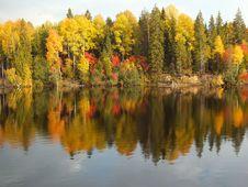 Free Autumn Foliage Along Waterfront Stock Photo - 82950930