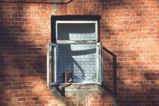 Free Window On A Brown Brick Wall Stock Photo - 82950970