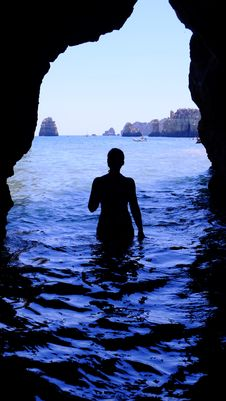 Free Silhouette Of Woman At Blue Sea Inside Black Cave During Daytime Stock Images - 82951104