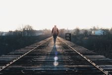 Free Man Walking On Railroad Bridge Royalty Free Stock Image - 82951106