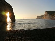 Free Sunrise Through Archway On Beach Royalty Free Stock Images - 82951299