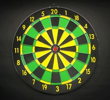 Free Green Yellow And Black Round Dart Board With Black Background Royalty Free Stock Photo - 82951365