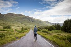 Free Man Looking Down A Country Road Royalty Free Stock Photo - 82951835